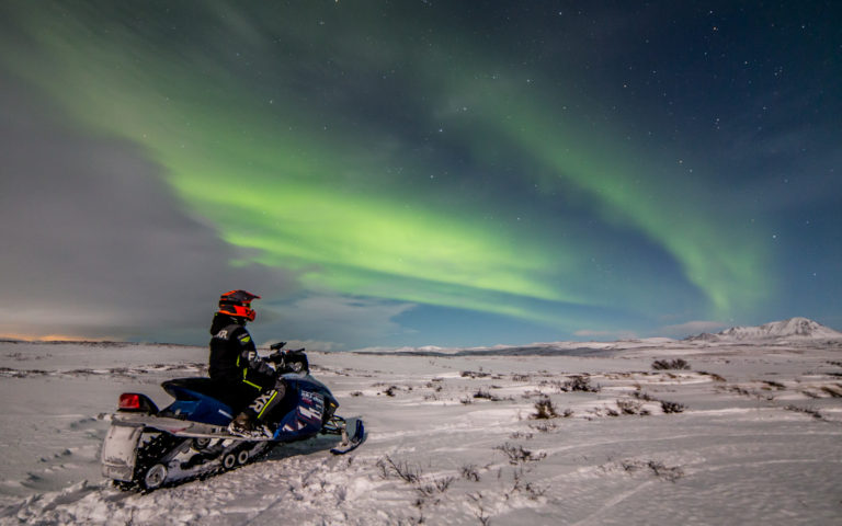 Northern light snowmobile tour